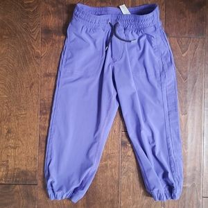 Ivivva lined purple joggers with pockets.